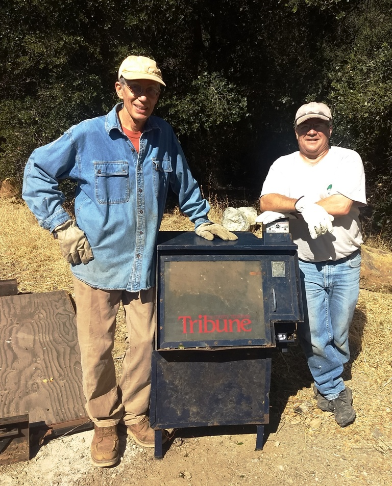John Goers and Mike Orvis pull the Tribune dispenser out of Atascadero Creek!