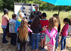 Kathe Hustace of Amigos de Anza participates as a docent in the curriculum-based field trip at Adobe Springs.