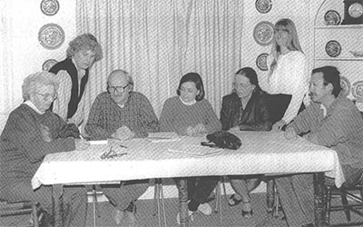Marj Mackey signing the incorporation papers in 1991.  Board Members (L to R): Marj Mackey, Lindsay Hampton, David Brown, Val Houdyshell, Joan O'Keefe, Ursula Luna, Dennis Loftus.  Missing was Karen Riggs and Gail Pollard.